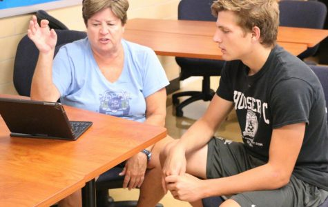 Senior, counselor provide college application advice