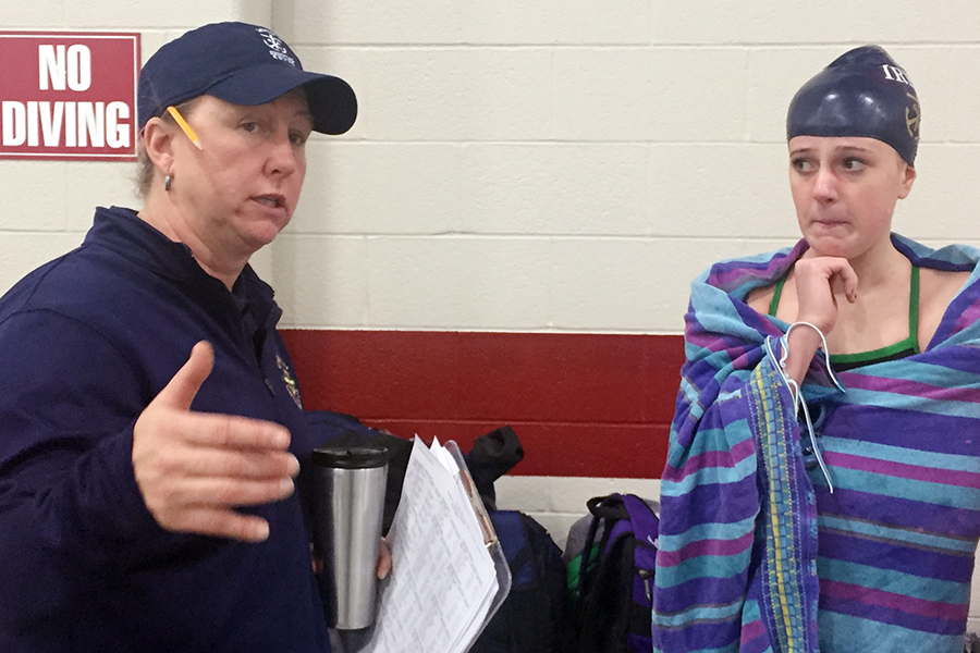 Head Coach Ms. Ashley Hill gives directions during the men's and women's swimming and diving meet Dec. 8 at Southport.