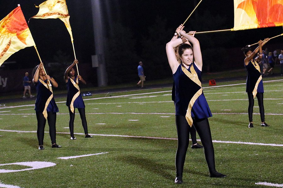 The color guard, shown performing during a football game in the fall, also will be part of the Dec. 9 band Christmas concert.