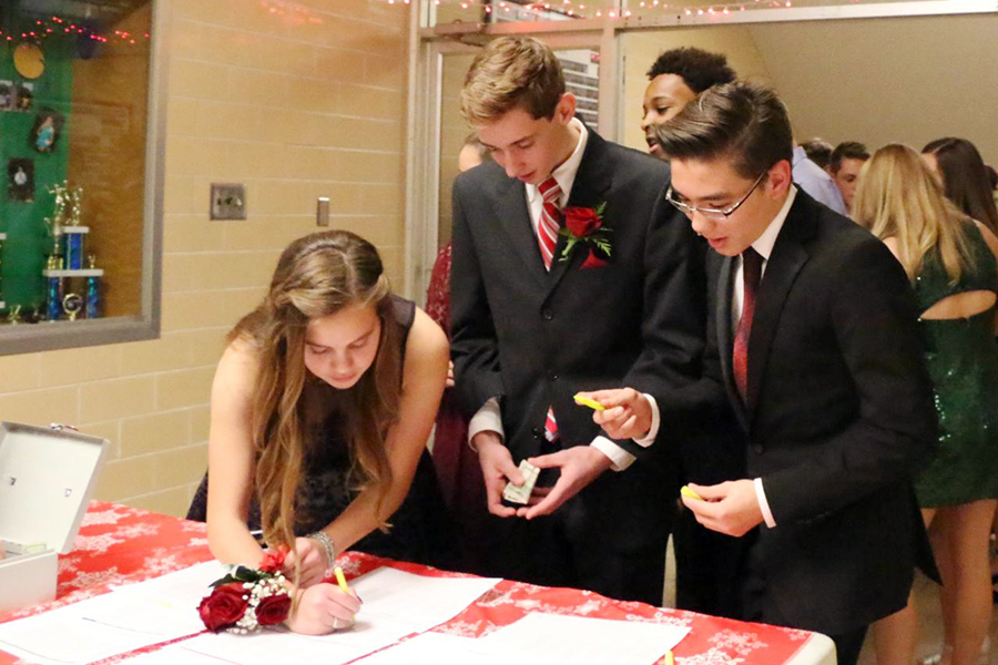Students signed in at last year's winter formal. The event this year will take place Dec. 8.