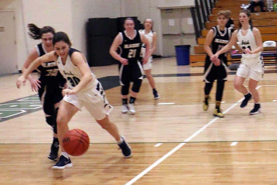 The women's varsity basketball team, shown in action last year, will play Heritage Christian on Jan. 10 in the semifinal round of the City tournament.