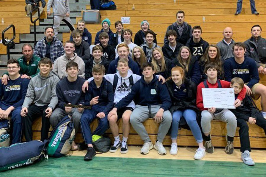 The+wrestling+team+poses+with+its+hardware+after+winning+the+Pendleton+Heights+Regional+on+Feb.+2.+
