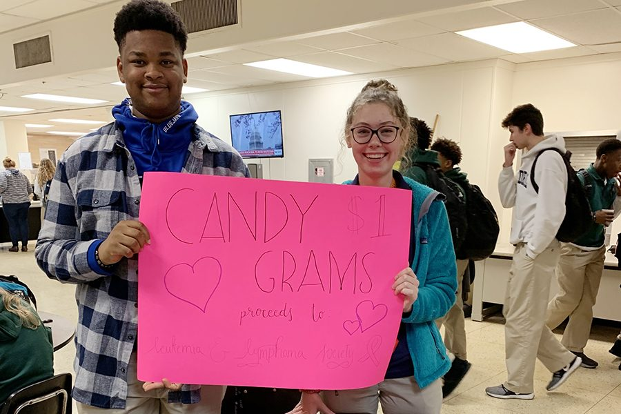 Senior+Joshua+Hall+and+sophomore+Madison+Ackley+promote+candygram+sales.