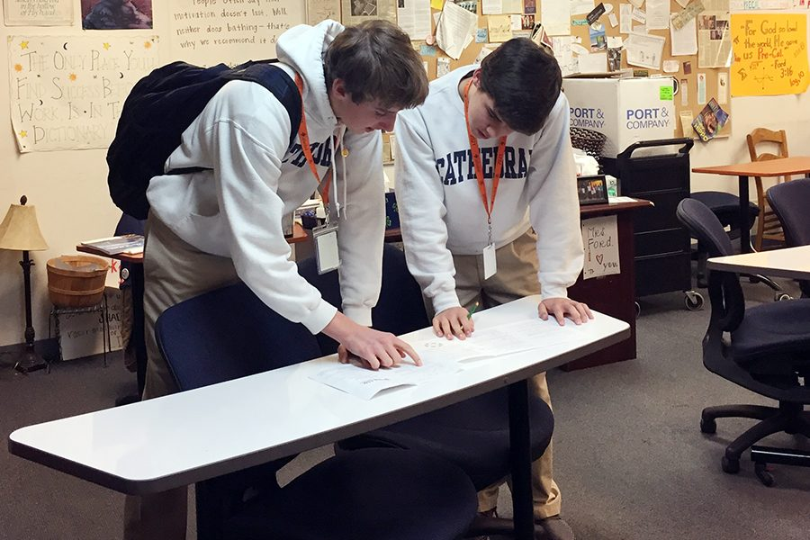 After they took the math competition exam, sophomores Levi Wojtalik and Isaac Michael discuss their solutions.