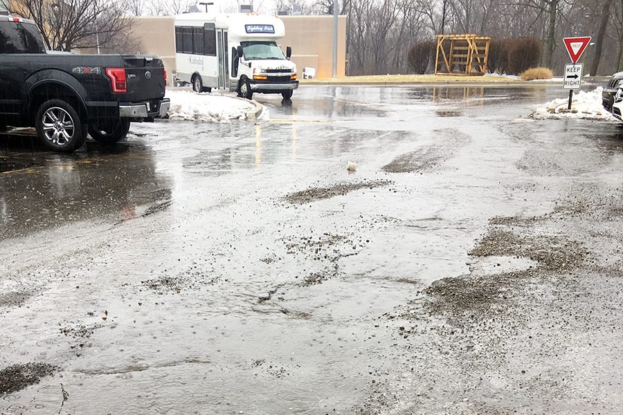 Once the weather improves, these potholes between the junior lot and circle will be filled.