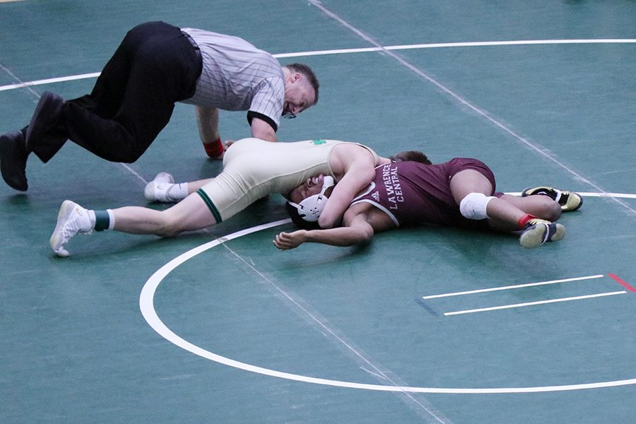 Five+members+of+the+wrestling+team+have+advanced+to+the+State+Finals+Feb.+15+and+Feb.+16+at+Bankers+Life+Fieldhouse%2C+where+they+hope+to+defend+their+2018+State+title.+