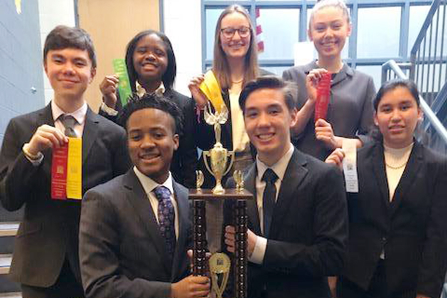 The sophomores who have qualified for the State meet on March 9 show off the Sectional championship trophy, which the entire team captured at Perry Meridian.