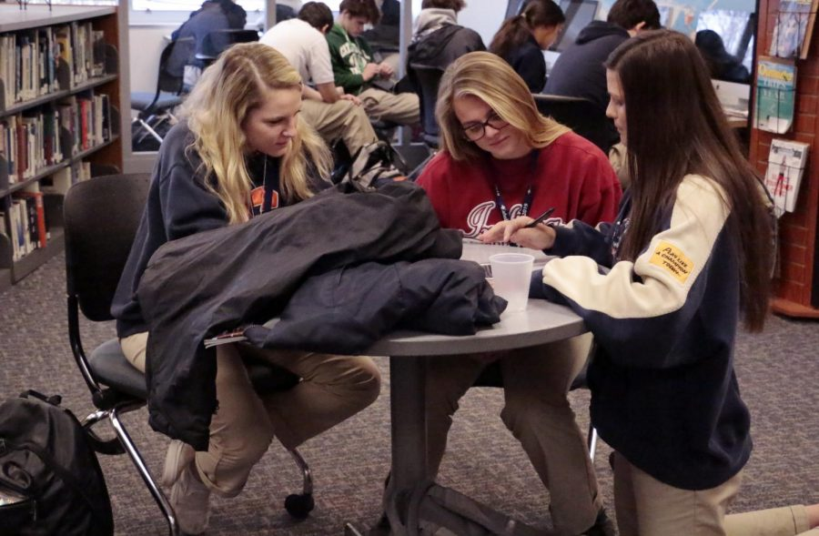 Seniors Oliva Carrico, Grace Brenton and Zoie Obst study during flex.