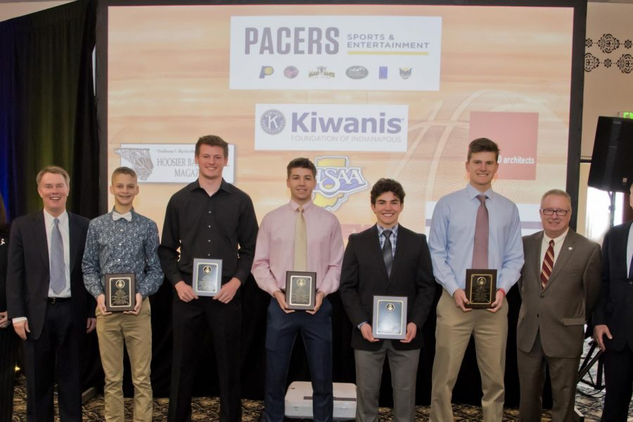 Senior+Ross+Welch%2C+on+the+right+in+a+blue+shirt+and+tie%2C+is+one+of+the+eight+recipients+of+this+year%27s+Kiwanis+basketball+scholarships.+On+Welch%27s+left+is+Mr.+Bobby+Cox%2C+commissioner+of+the+Indiana+High+School+Athletic+Association.+