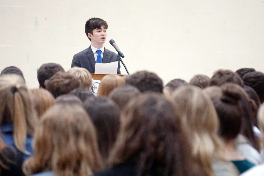 Senior Brendan Hurley speaks during the National Honor Society induction ceremony on April 28.
