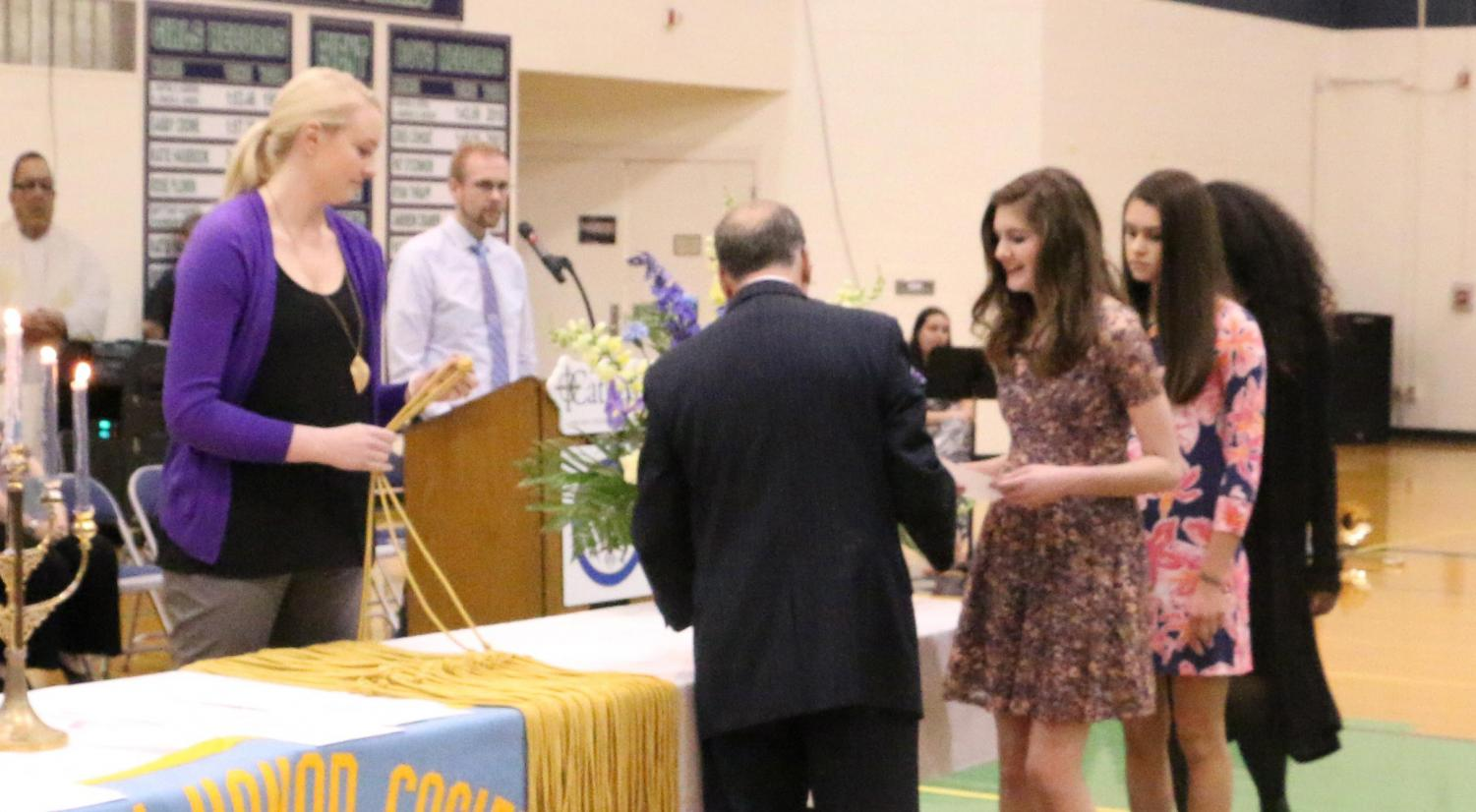 Students from the Class of 2017 receive their chords at the National Honors Society ceremony. This year's event will take place April 28 in the Welch Activity Center.