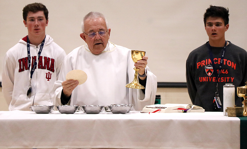 Fr. Jeff Godecker celebrates a school wide Mass last year in the Welch Activity Center.