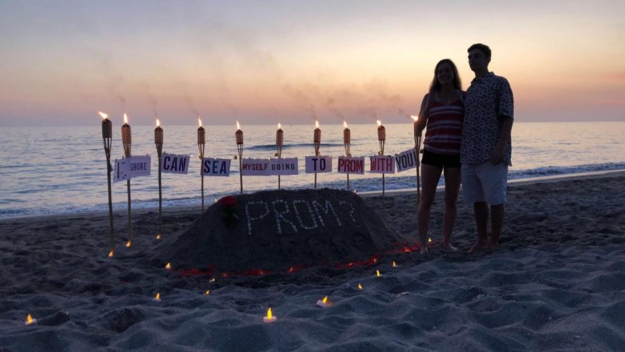 The+promposal+between+juniors+Cole+Spau+and+Nico+LoPresti+took+place+on+a+beach.+