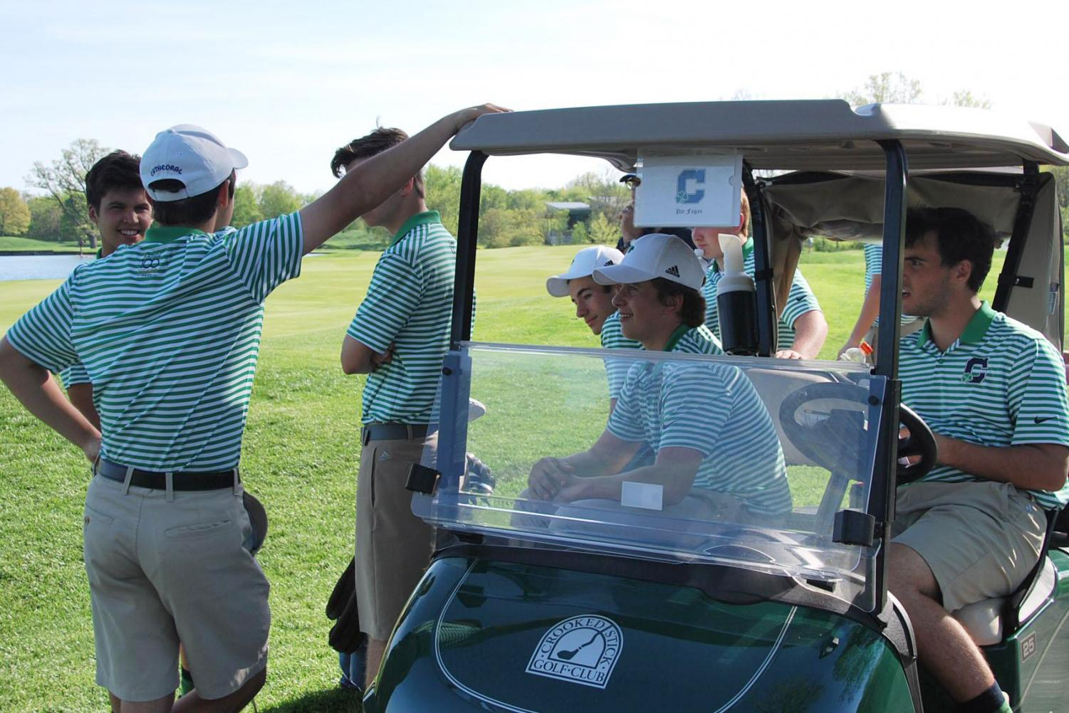 Golf caddies may apply for the Evans Scholarship for tuition at Indiana University or Purdue University. Members of the golf team prepare for the State Finals last season.