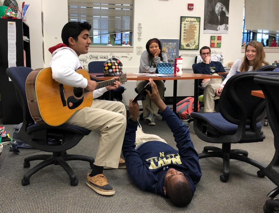 "Chase Santamaria '18 plays guitar for classmates as part of a school project. ""There are easy ways to fit studying into your day without losing any part of the other three components (spiritual, physical and emotional),"" Santamaria said."