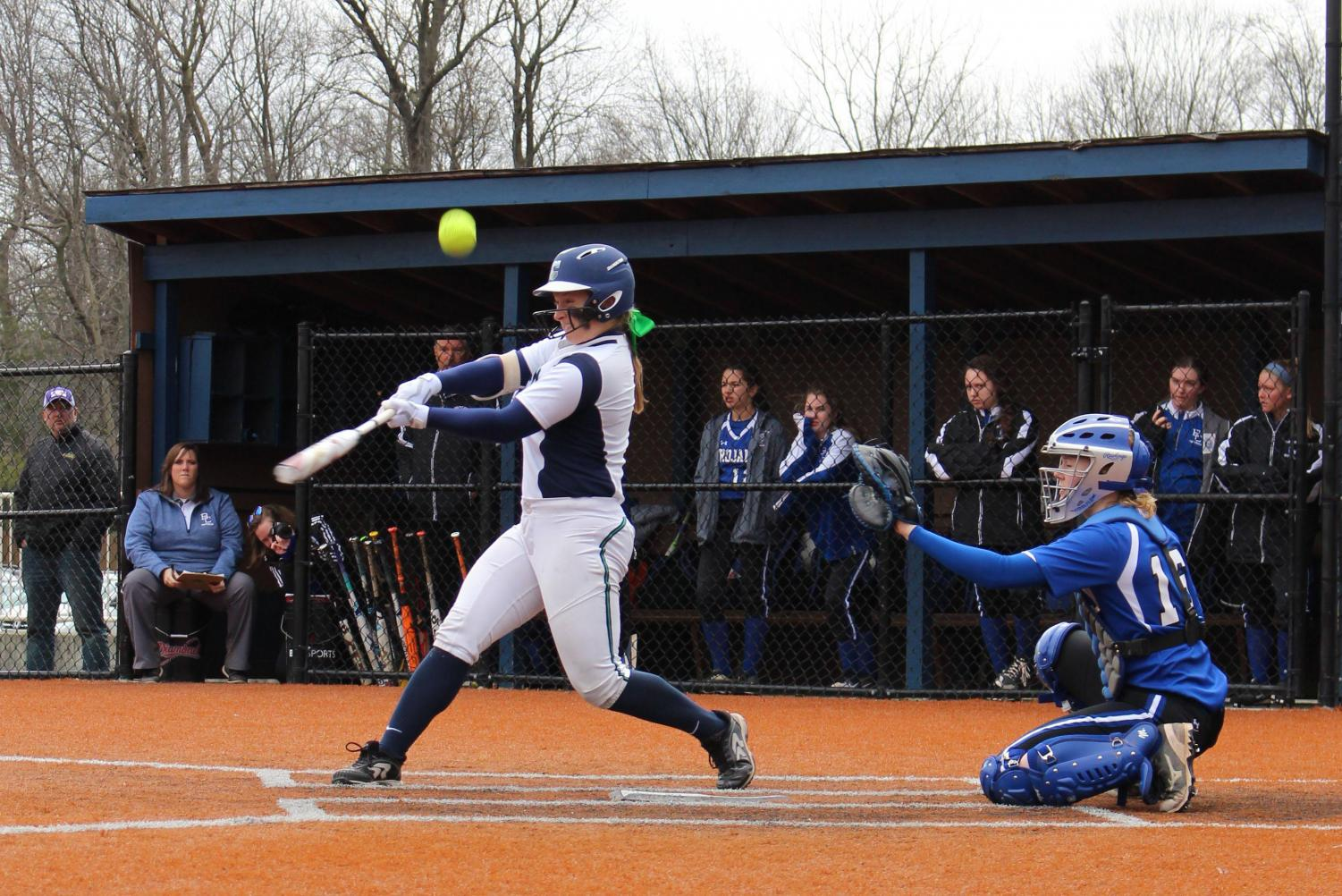 The varsity softball team, shown in action last year, plays several games during the week of April 8.