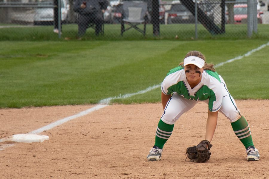 Junior Emily Timberman gets into her defensive stance at third base during a game earlier this season. The softball team opens Sectional play on May 21.