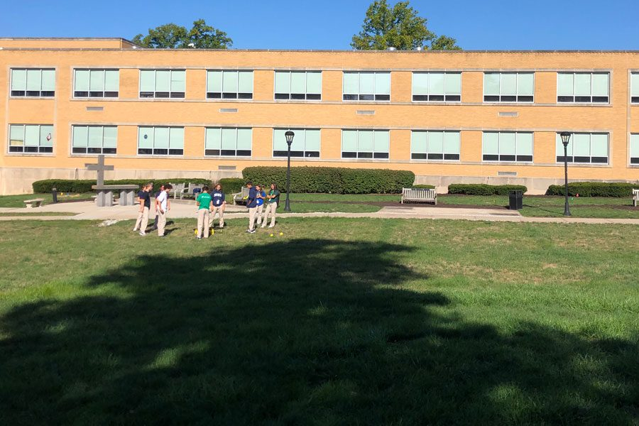 During E period on Aug. 29, students gather in the courtyard, part of which adjacent to Kelly Hall will be the site of the new STEM building/Innovation Center.