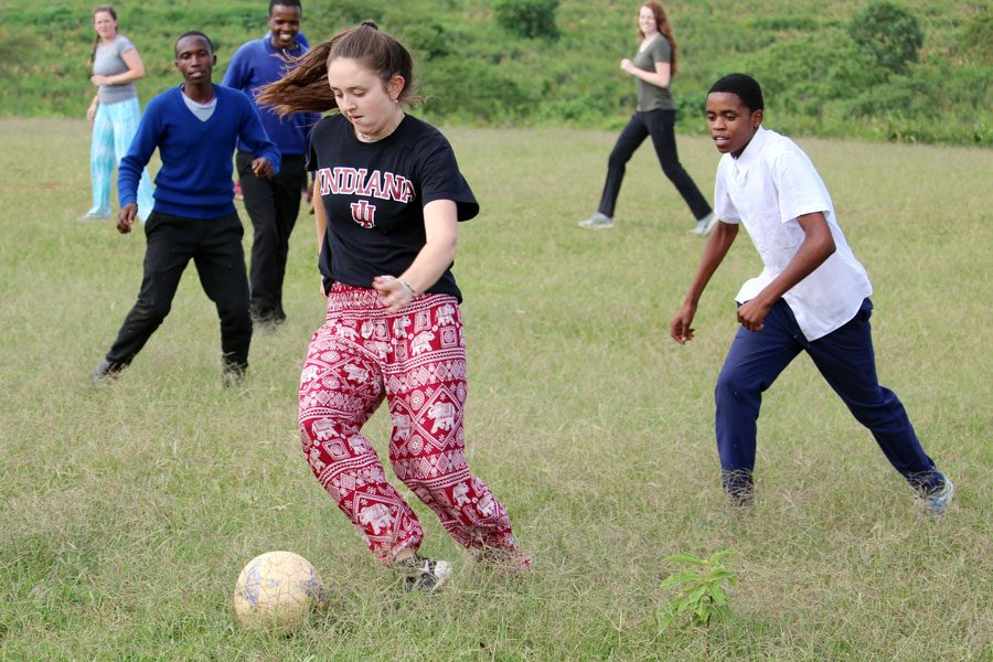 Senior Marcelle Blanchet plays soccer during the In Our Village trip to Africa over the summer.