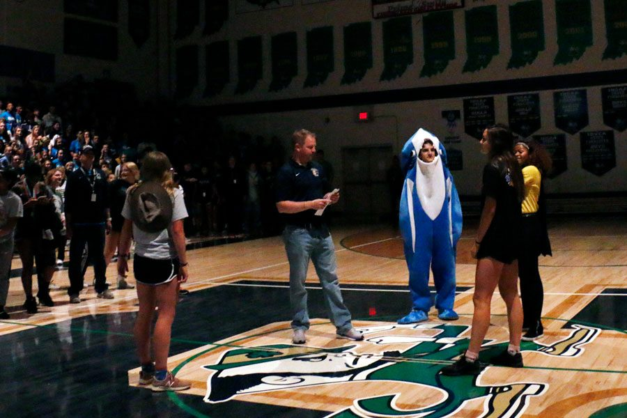 Former Vice Principal Mr. Jere Kubuske returned to campus to help announce the annual winner of the Homecoming spirit stick. He gathered the four class presidents on the basketball court just before the seniors were announced as the spirit stick winners.