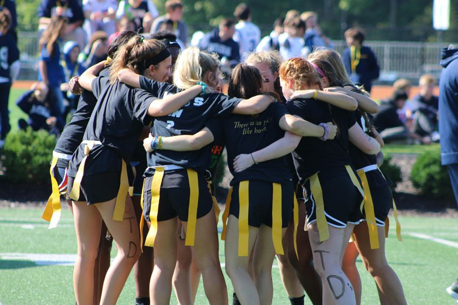 Members+of+one+of+the+powderpuff+teams+gather+on+the+practice+field+last+year.+