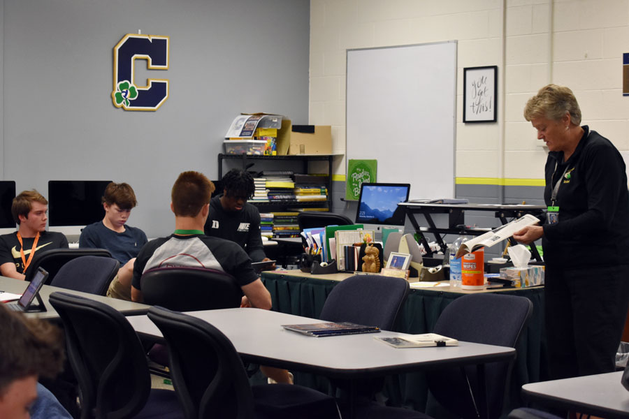 Ms. Jean Kesterson instructs a personal finance class that teaches students real-world money skills.