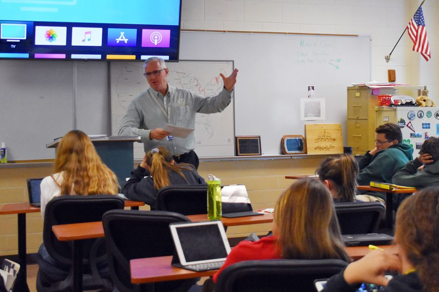 Social studies teacher Mark Mathews teaches his E period dual credit  American history class.