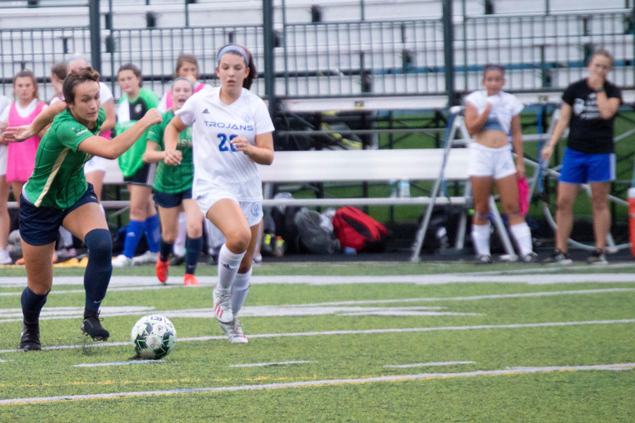 Senior Maddie Wirth advances the ball against Bishop Chatard. The Irish open Sectional play on Oct. 8.