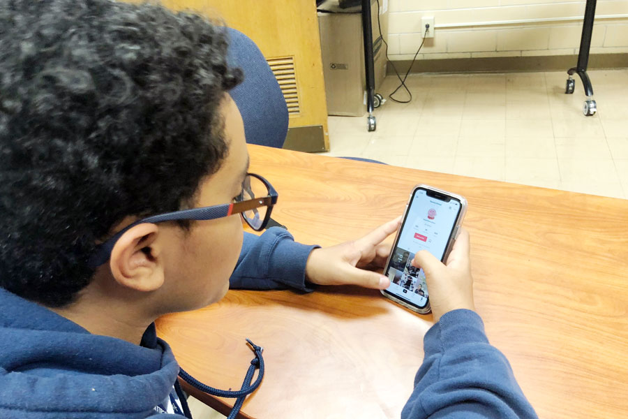 Students often check out TikTok during their resource. Freshman Adriel Jose views a video during G period.