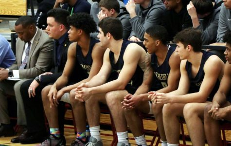 The men's basketball team views the action during last year's Sectional. Tryouts for this year's squad begin Nov. 11.