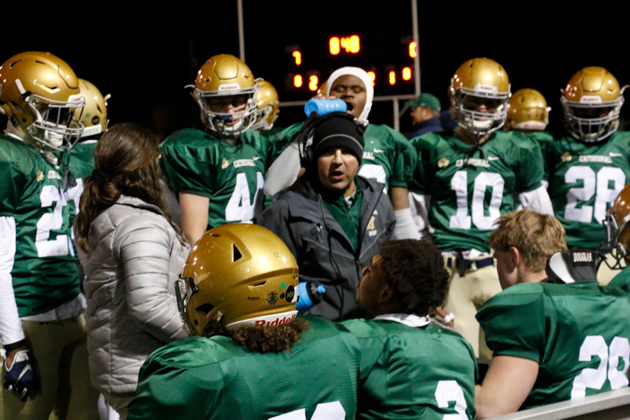 The football team will travel to New Palestine on Nov. 15 for the Regional championship game. The team receives instructions during its Nov. 8 win over Decatur Central in the Sectional title game.