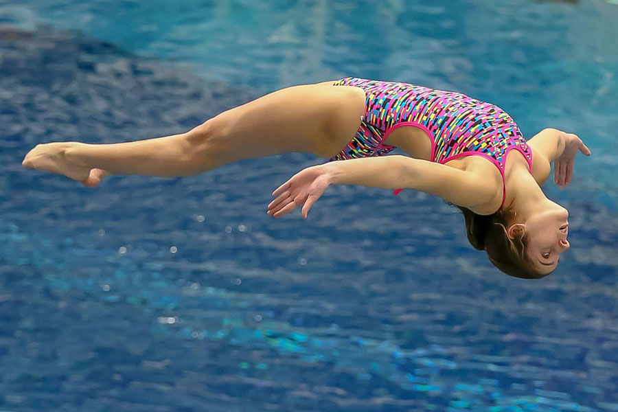 Senior Sophie Mernitz dives in last year's State meet.