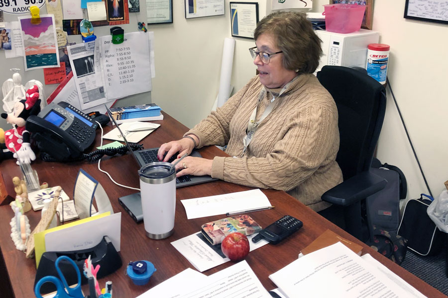 Mrs. Charlene Witka works at her desk in the Shiel Student Life Center.