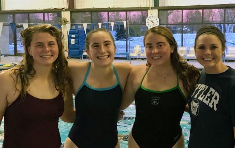 Members of the women's swimming and diving team take a break during a recent practice.