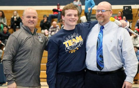 Senior Jacob Huffman, who both wrestles and sings in the choir, is recognized at Senior Night on Jan. 22 in the Welch Activity Center.
