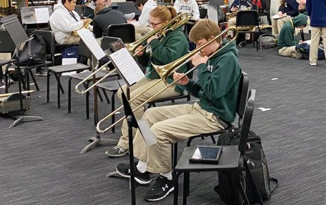 In the band room in the basement of Cunningham Hall, student musicians warm up before a recent practice.