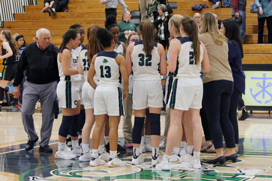 The+women%27s+basketball+team+gathers+around+its+coaches+during+the+varsity+game+in+December+against+Zionsville.+