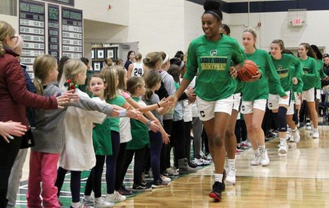 During CYO Night earlier this season, senior Justis Gordon leads the Irish onto the floor in the Welch Activity Center.