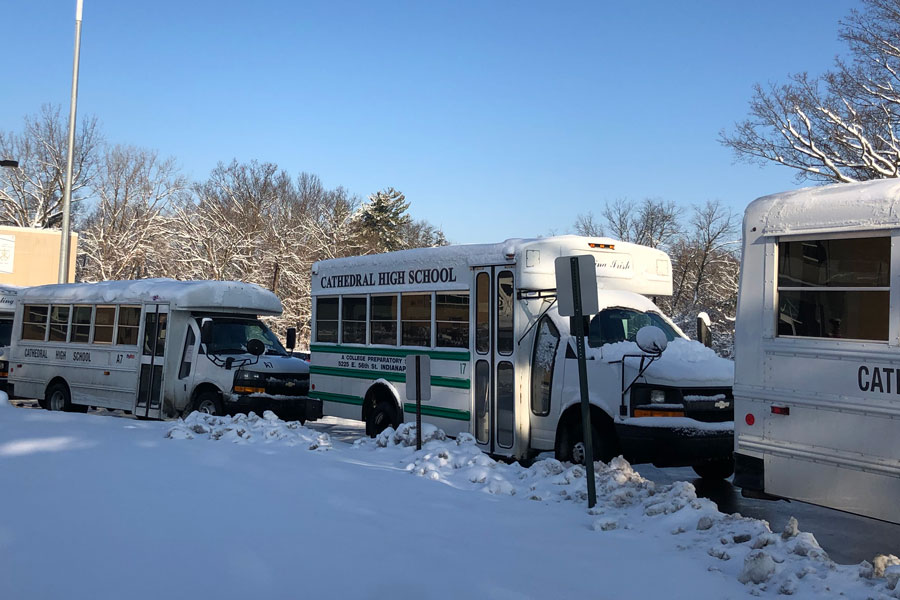 In December, buses line up on the traffic circle, ready to transport students to their homes.