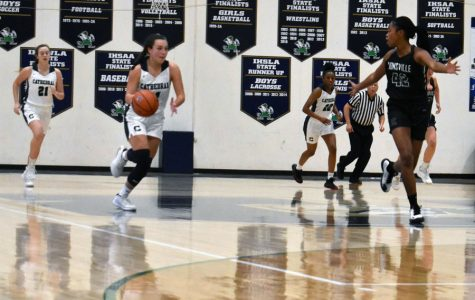 Senior Cassie Piper brings the ball up the court during a recent home game.
