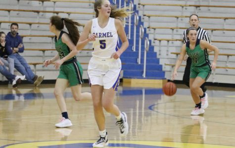 Senior Cassie Piper brings the ball up the court during the Jan. 28 varsity game at Carmel. The Irish open Sectional play on Jan. 5.