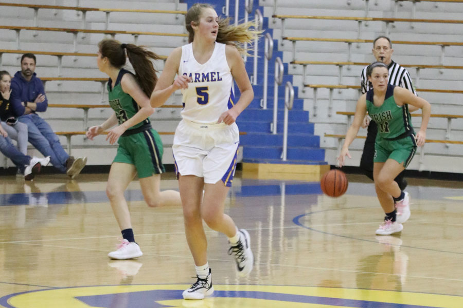 Senior+Cassie+Piper+brings+the+ball+up+the+court+during+the+Jan.+28+varsity+game+at+Carmel.+The+Irish+open+Sectional+play+on+Jan.+5.+