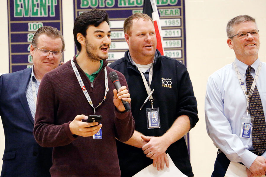 With microphone in hand, Mr. Tristan Zavaleta led the singing at the multicultural assembly earlier this school year.