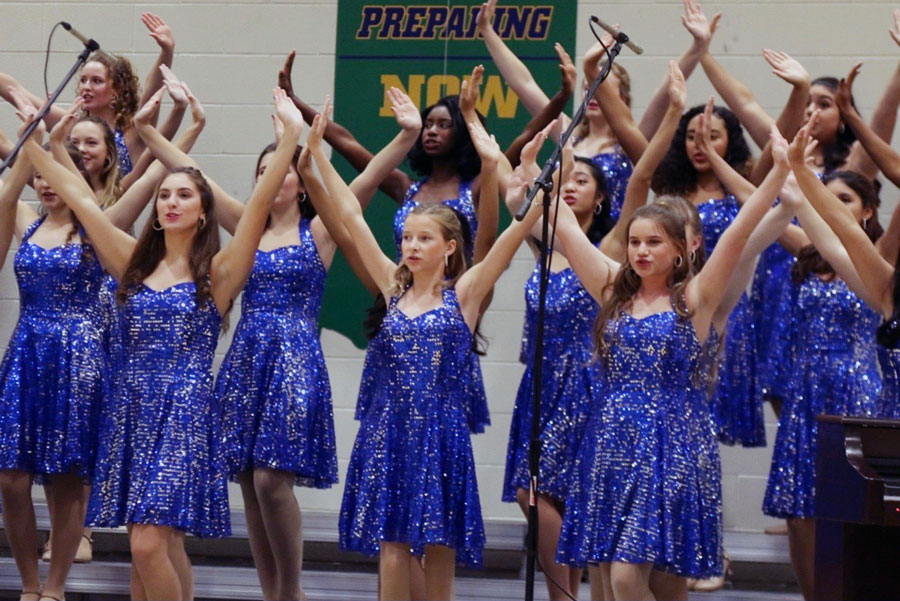 The show choir performs during Open House.