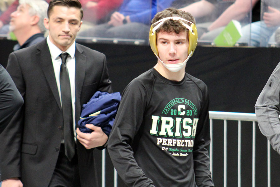 Sophomore Zeke Seltzer prepares to take to the mat at the wrestling State Finals at Bankers Life Fieldhouse.