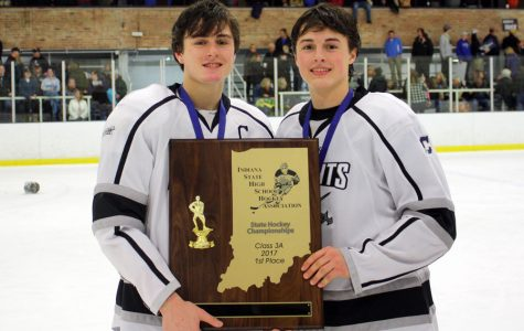 The Bedich brothers, David on the left and Sam on the right, take the ice with the 2017 State championship trophy.