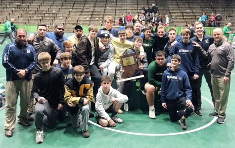The wrestling team shows off its Semistate championship trophy on Feb. 15 at New Castle.