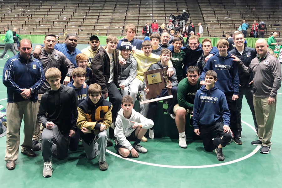 The+wrestling+team+shows+off+its+Semistate+championship+trophy+on+Feb.+15+at+New+Castle.+