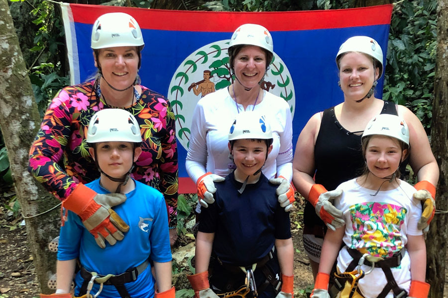 Mrs. Karen Hovanec, top left, and her fellow 2019 spring break travelers in Roatan, Honduras about to go zip lining.