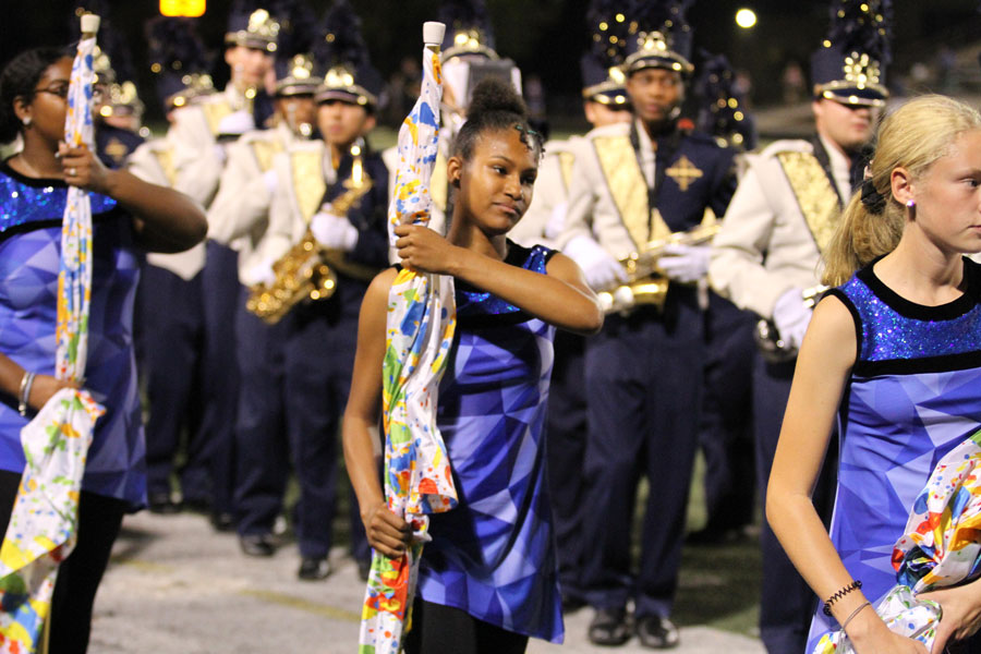 The Color Guard participates in the halftime show during the football Homecoming game against Jeffersonville.